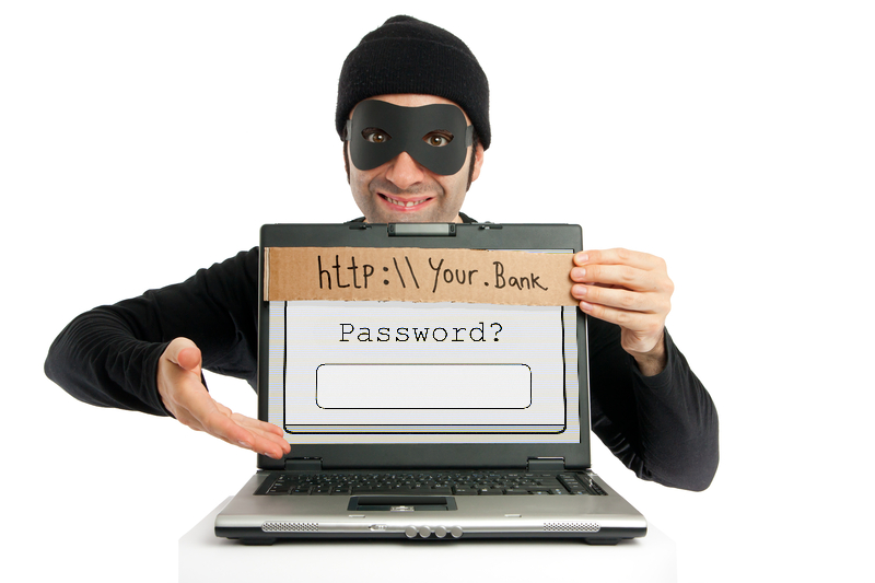 Man in black and eye-masked pops up from behind a laptop screen and hides the real URL and plants a fake one on top